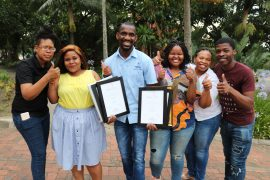 Thumbs up for six awards won at the 2018 MACE Excellence Awards ceremony! From left: Hlumelo Nyikana, Multimedia Journalist; Nompilo Dlamini, Public Relations Officer; Sphamandla Gumede, Public Relations Assistant; Naledi Hlefane, Publications Officer; Precious Shamase, Communications Officer and Samkele Sokhela, Multimedia Journalist.